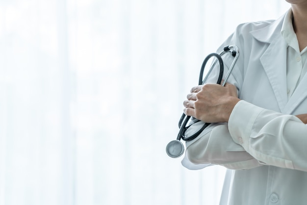 Female doctor holding stethoscope Premium Photo