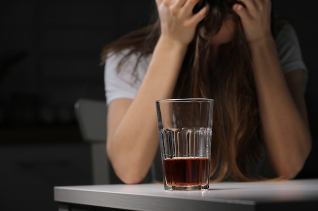 Female doctor is depressed. lonely female drinker alcoholic suffer from alcohol addiction having problem, alcoholism concept. the consequences of a pandemic and self-isolation Premium Photo