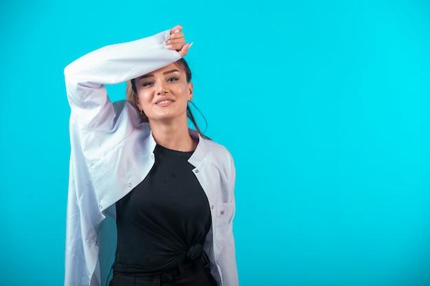Female doctor in white uniform feels tired. Free Photo