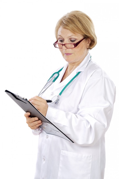 Female doctor writing a over white background Premium Photo