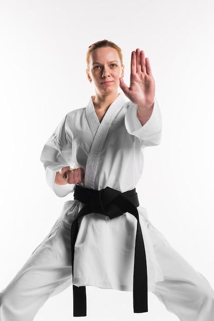 Female doing karate pose front view Premium Photo