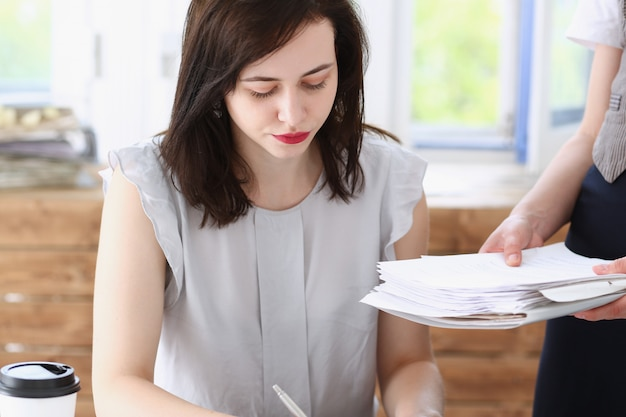 Female employee showing pack of documents Premium Photo