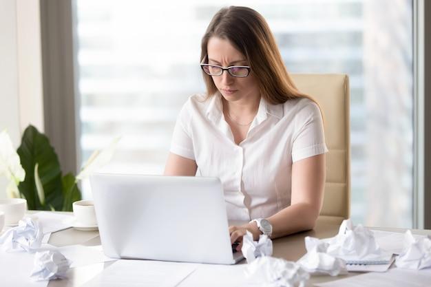 Female entrepreneur preparing report to deadline Free Photo