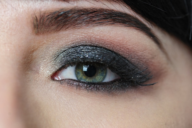Female eye and eyebrow with makeup close-up Premium Photo