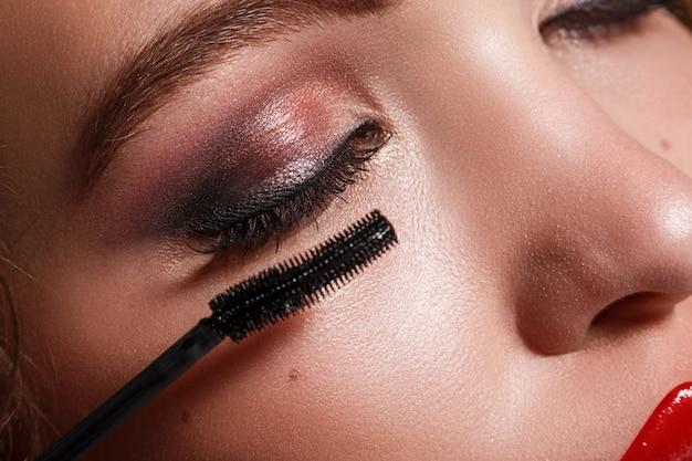 Female face and mascara brush Premium Photo