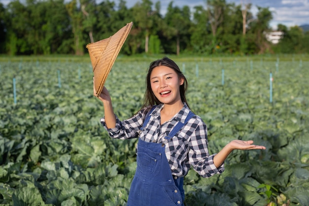 Female farmers who are happy with the crops in their gardens. Free Photo