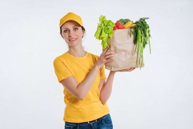 Female food delivery worker with food package Free Photo