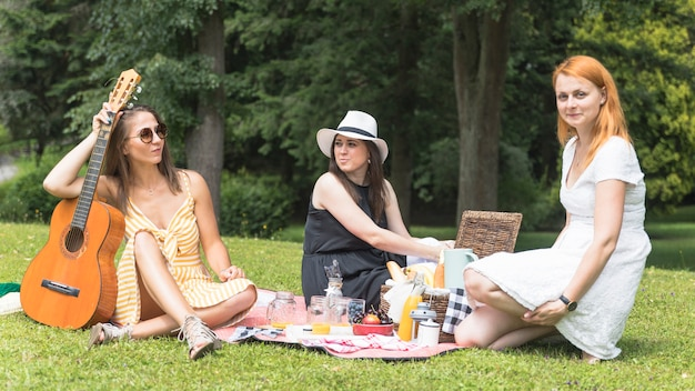 Female friends enjoying on the picnic in the park Free Photo