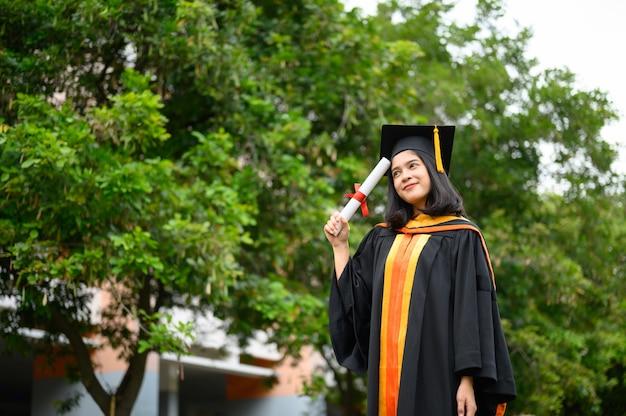 Female graduates celebrate the university graduation day Premium Photo