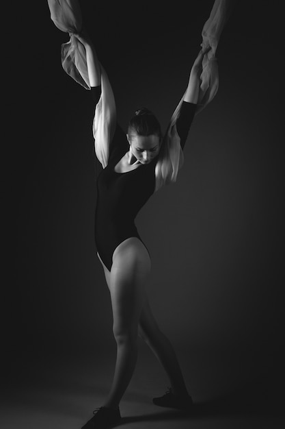 Female gymnast posing on a black background Premium Photo