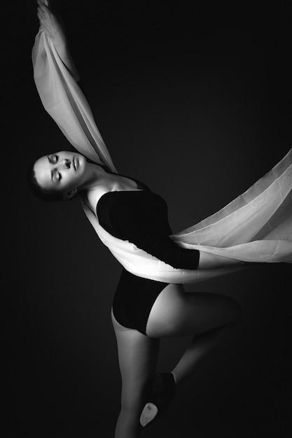 Female gymnast posing on a black background Premium Photo