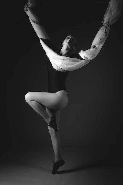 Female gymnast posing on black Premium Photo