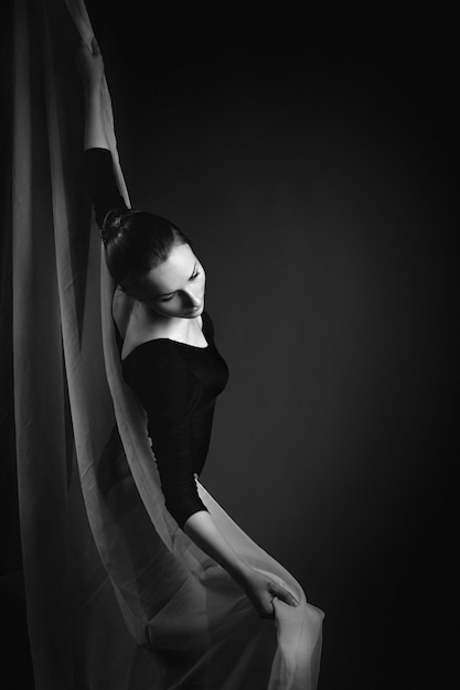 Female gymnast posing on black Premium Photo