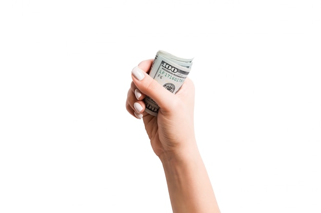 Female hand giving money. top view of dollar banknotes. bribe concept. debt and loan concept Premium Photo