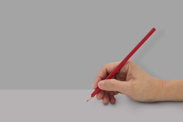 Female hand with red color pencil Premium Photo