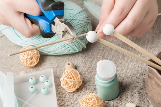 Female hands cutting stick Premium Photo