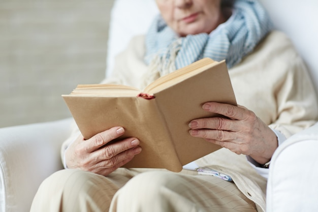Female hands holding book Free Photo