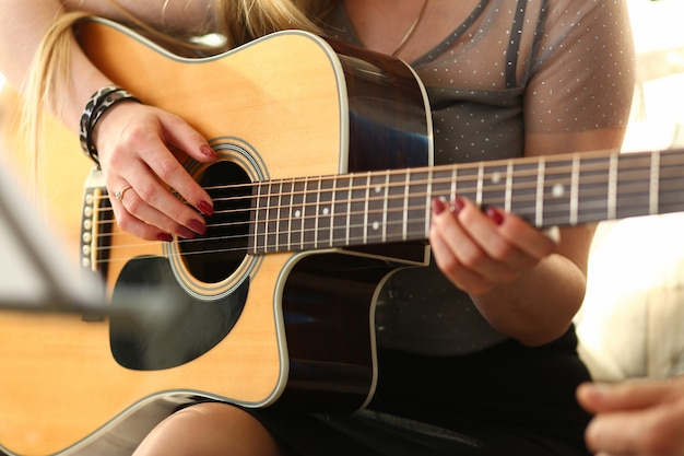 Female hands holding and playing western Premium Photo