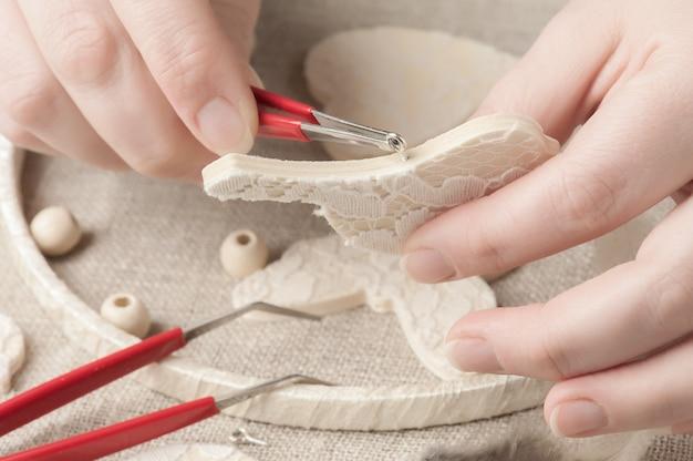 Female hands holding tool Premium Photo