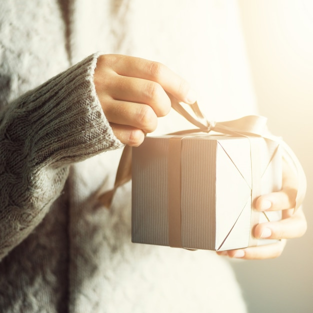 Female hands opening gift box, copy space. christmas, hew year, birthday concept. banner Premium Photo
