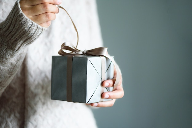 Female hands opening gift box, copy space. christmas, hew year, birthday concept Premium Photo