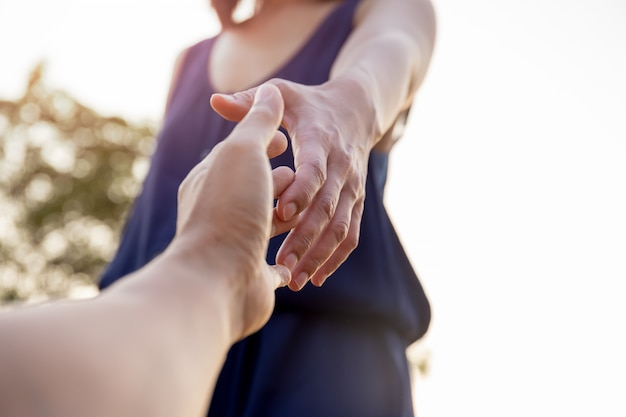 Female hands reaching out for help each other. Premium Photo