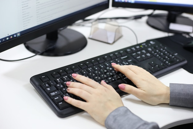 Female hands typing on computer Premium Photo