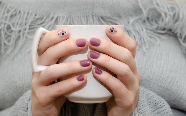Female hands with dark pink nail design Premium Photo