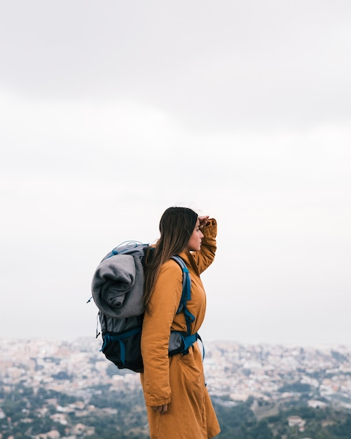 Female hiker with his backpack looking at view Free Photo
