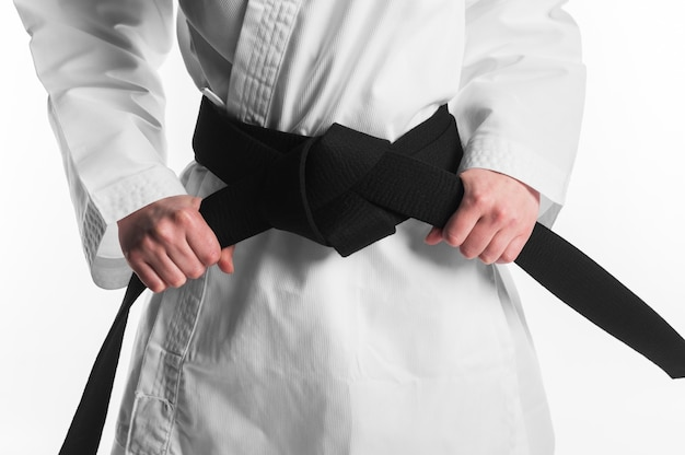 Female holding karate black belt Free Photo