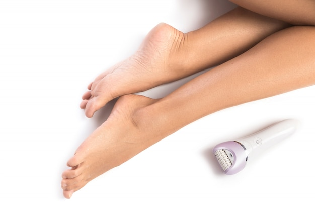 Female legs and epilator Premium Photo