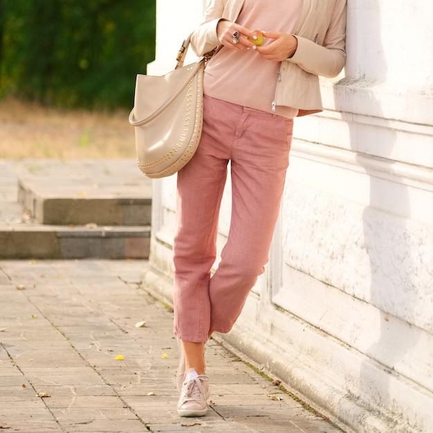 Female legs in linen trousers. Premium Photo