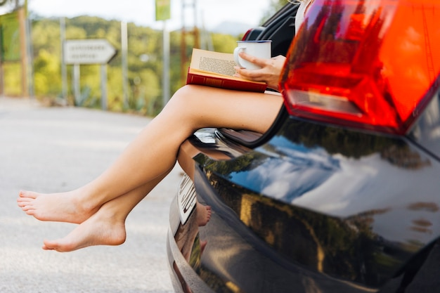 Female legs out of car trunk Free Photo