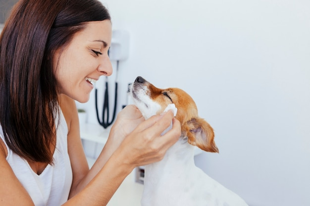 Female in love with her healthy dog Premium Photo