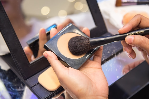 Female makeup artist with cosmetics at work close-up Premium Photo