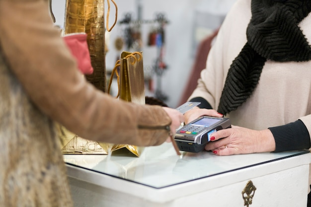Female making purchase with credit card Free Photo