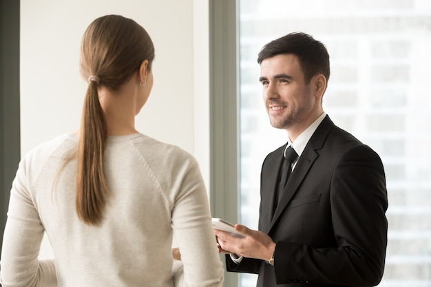 Female and male colleagues meeting in office Free Photo