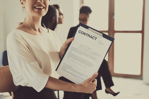Female manager holds contract. staff development. Premium Photo
