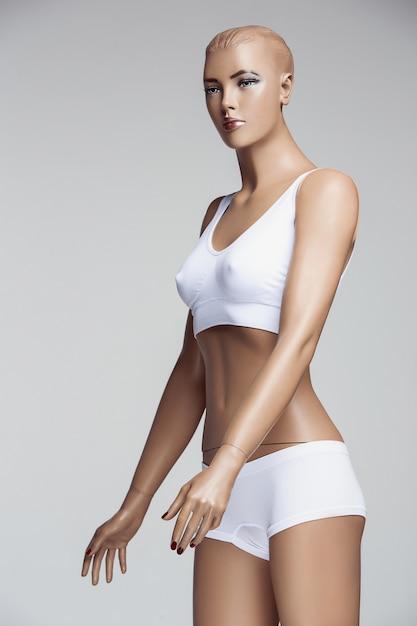 The female mannequin on gray studio Free Photo