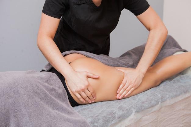 Female masseur makes anticellulite massage young woman close up Premium Photo