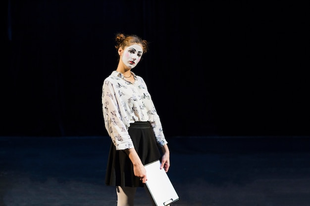 Female mime with manuscript looking at camera Free Photo
