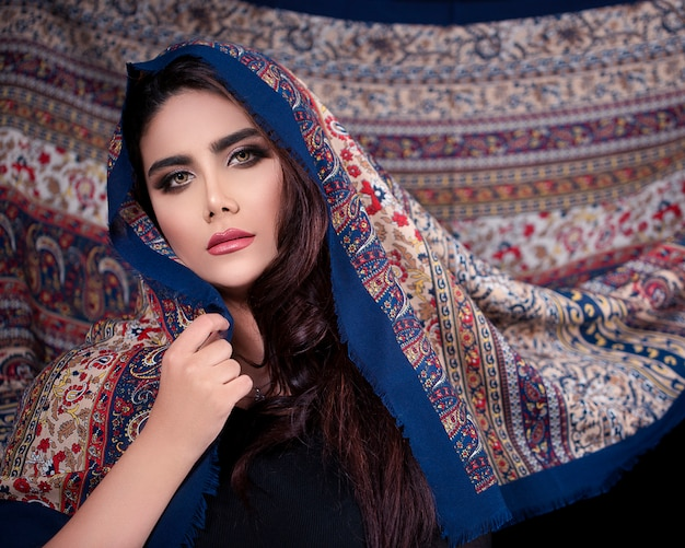 Female model adverting oriental style hijab with patterns Free Photo