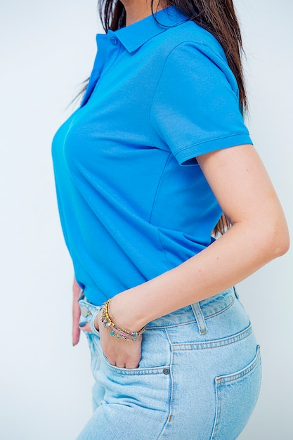Female model promoting jeans and tshirt for ecommerce clothes website. Free Photo