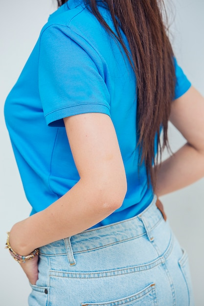 Female model promoting jeans and tshirt for online sales. Free Photo