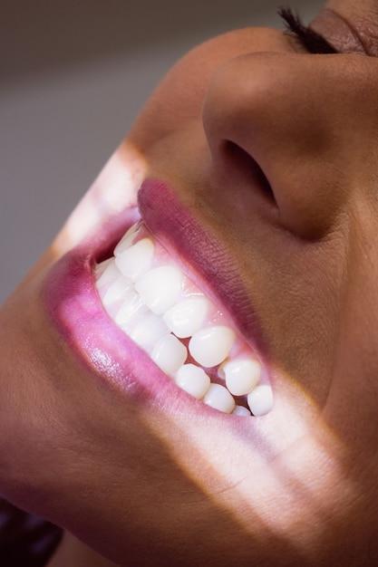 Female patient receiving a dental treatment Free Photo