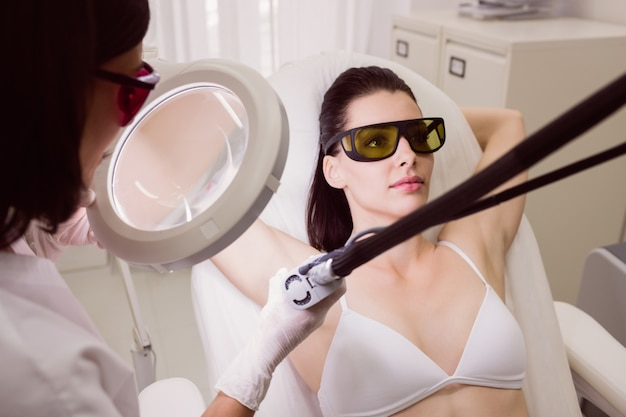Female patient receiving laser hair removal treatment Free Photo