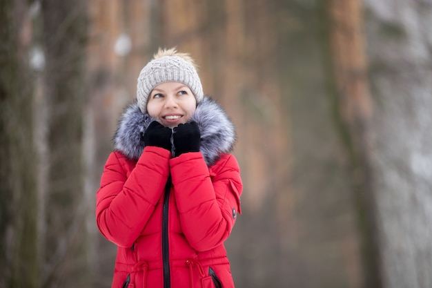 Female portrait outdoors in red winter jacket Free Photo