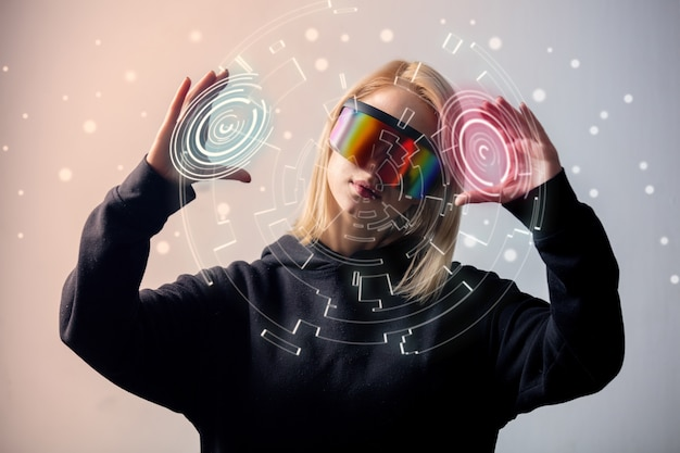 Female programmer works with personal data in virtual glasses Premium Photo