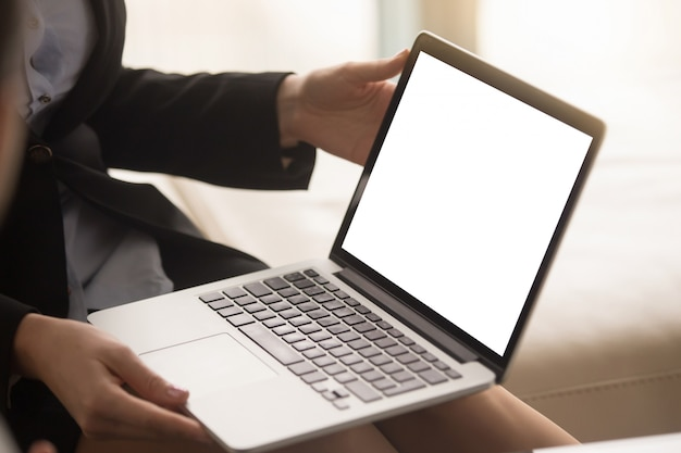 Female real estate agent showing house plan on laptop screen Free Photo