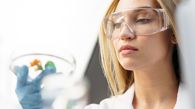 Female researcher with safety glasses in the lab Premium Photo